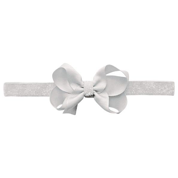 Medium boutique Milledeux bow – elastic hairband – white colored glitter