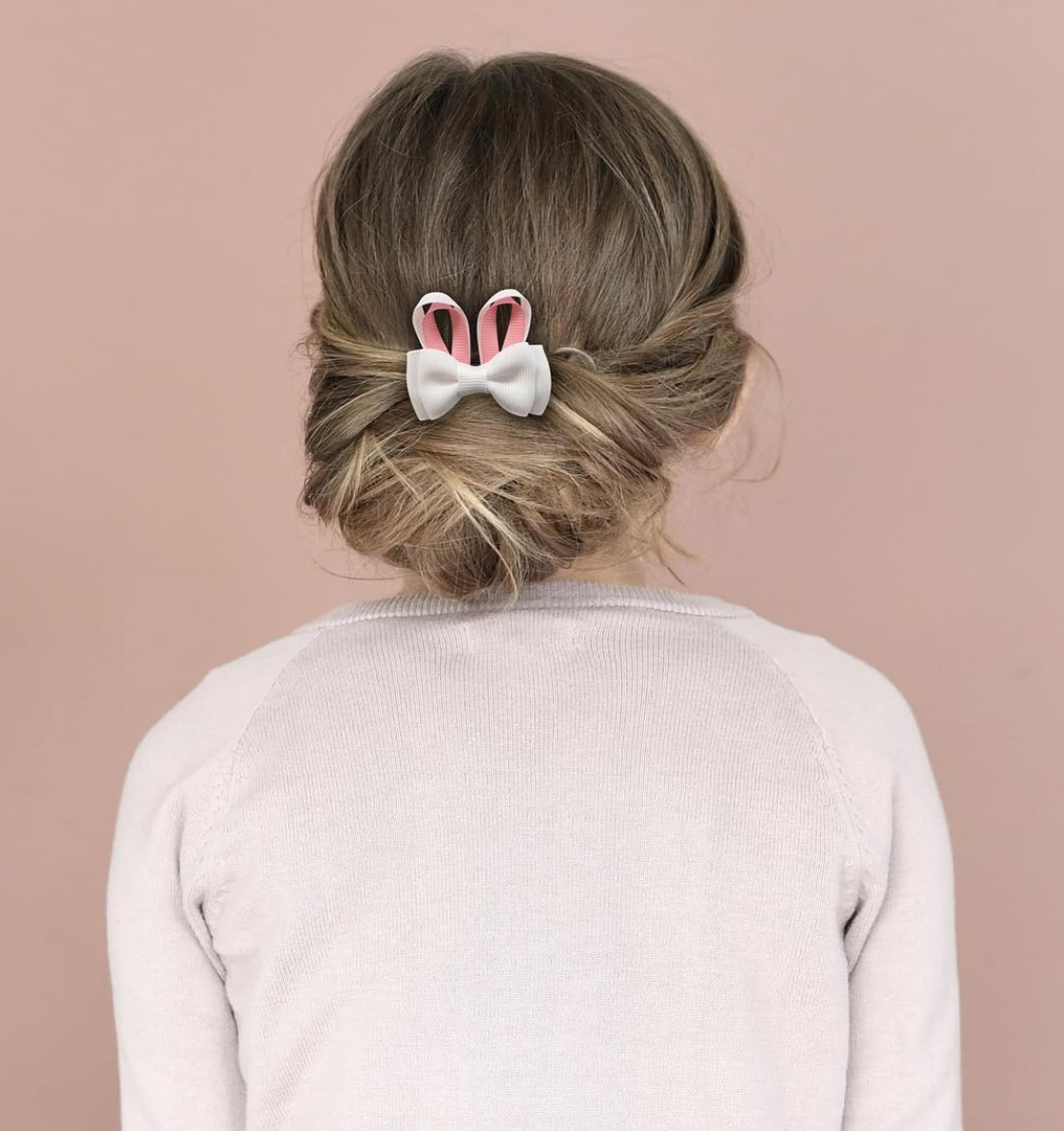 messy bun with hair bow