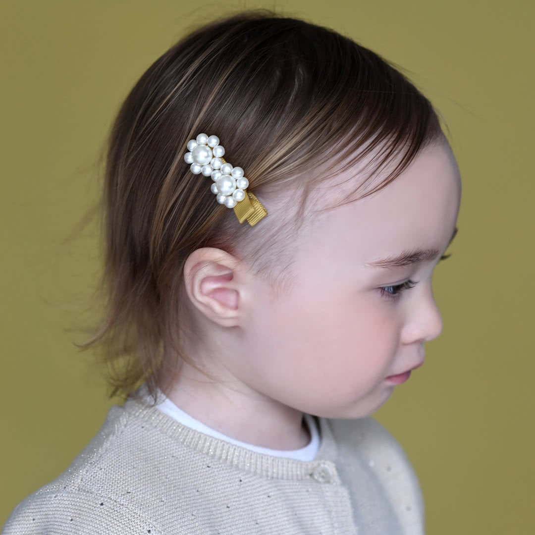 Cute hairstyle for toddler hair - white yellow pearl hair clip
